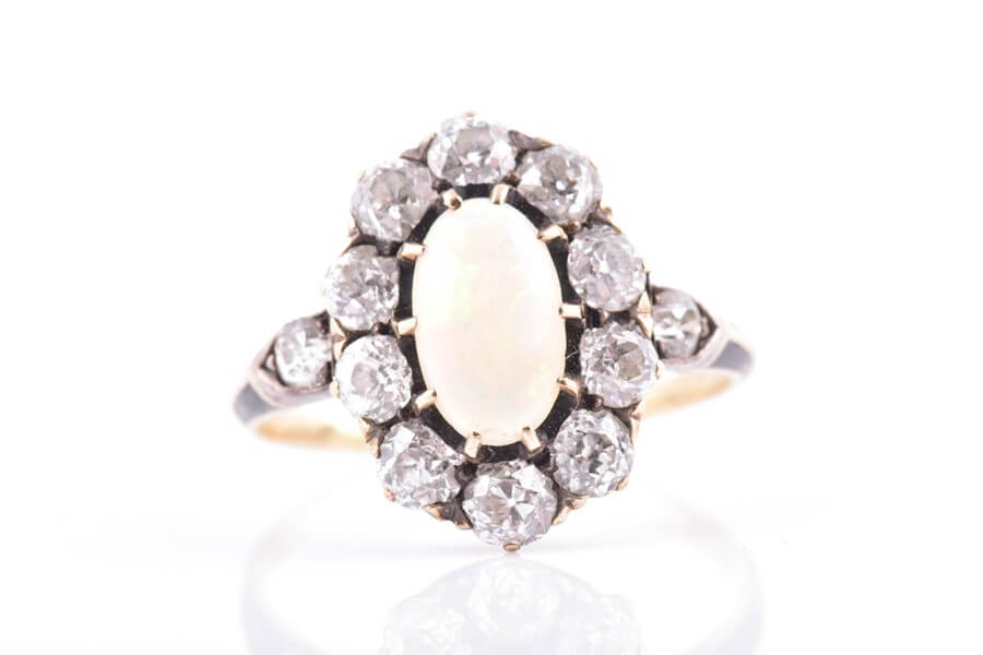 A late 19th / early 20th century diamond and opal cluster ring