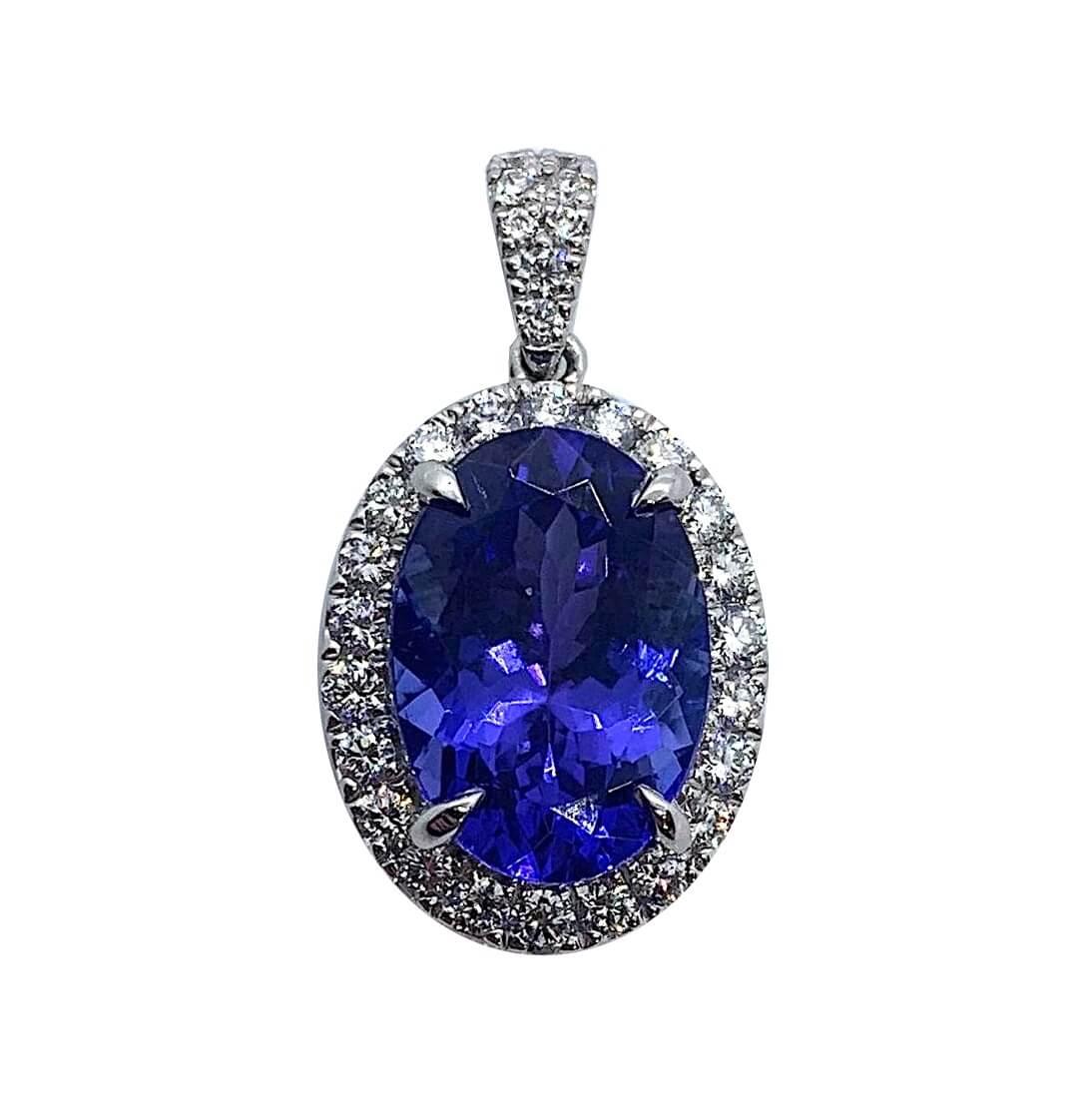 An 18ct white gold, tanzanite and diamond pendant