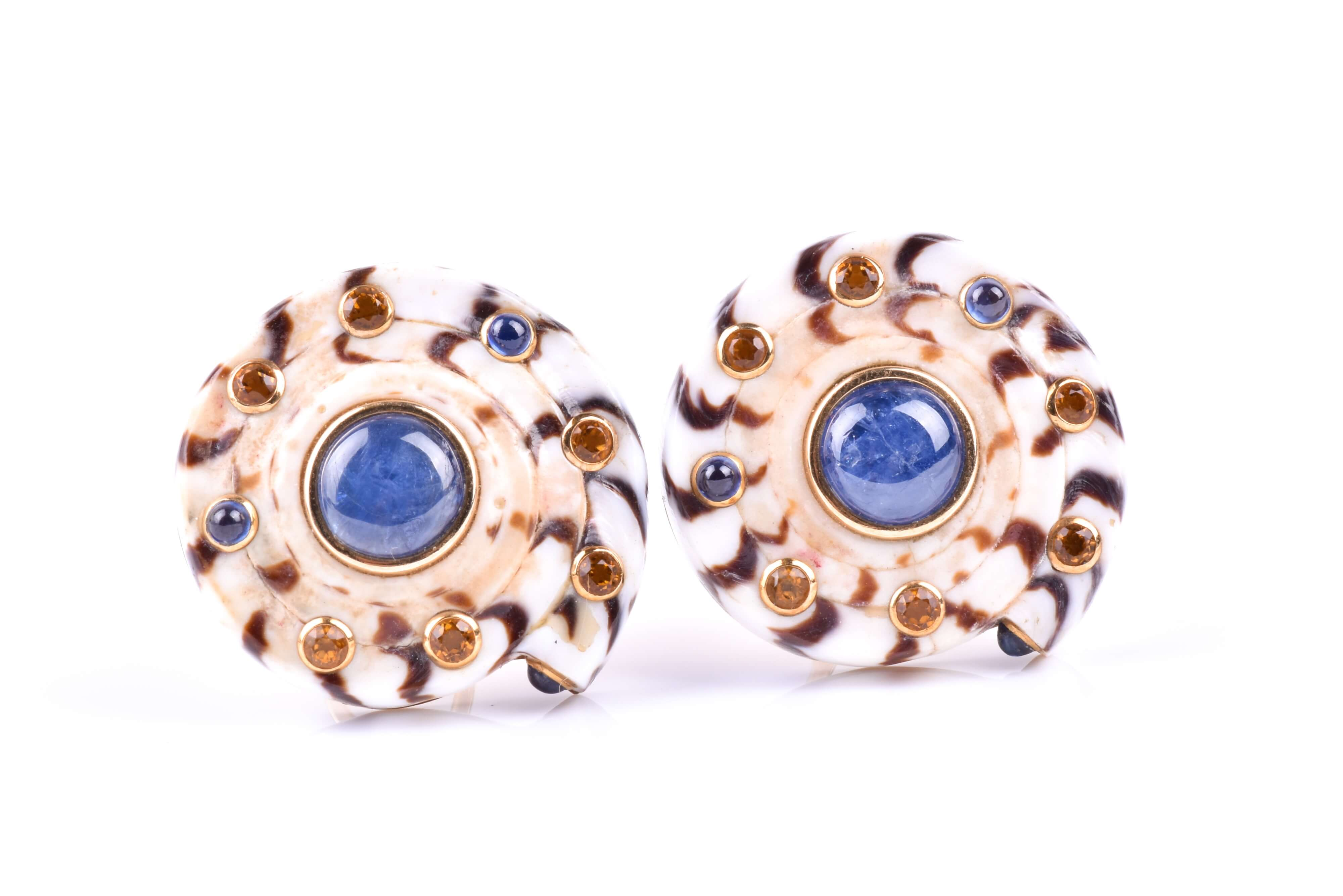 Trianon. A pair of sapphire and topaz shell earrings, set with topazand cabochon sapphire accents.