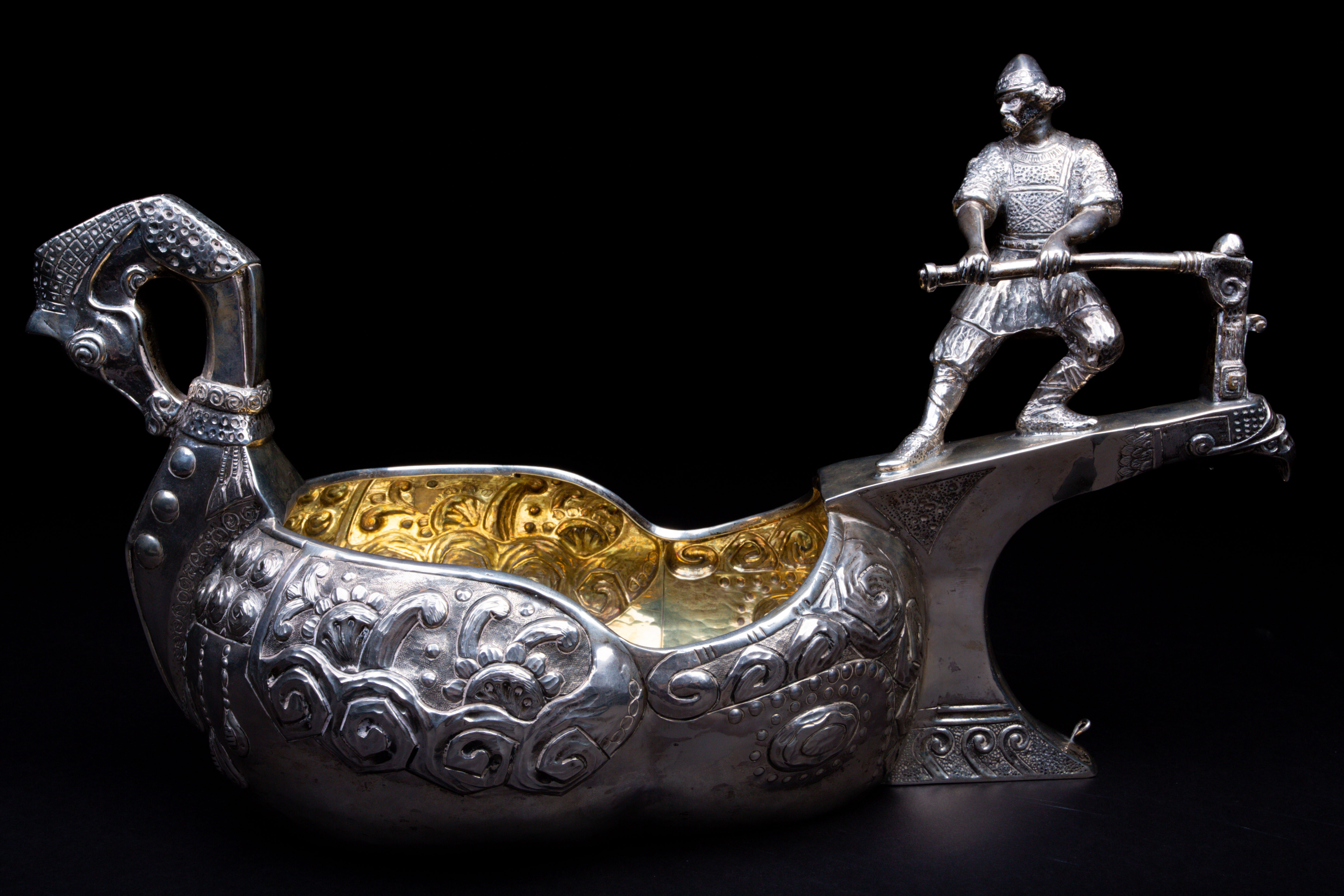 A large Russian silver Norse inspired kovsh. Sold for £4,500.