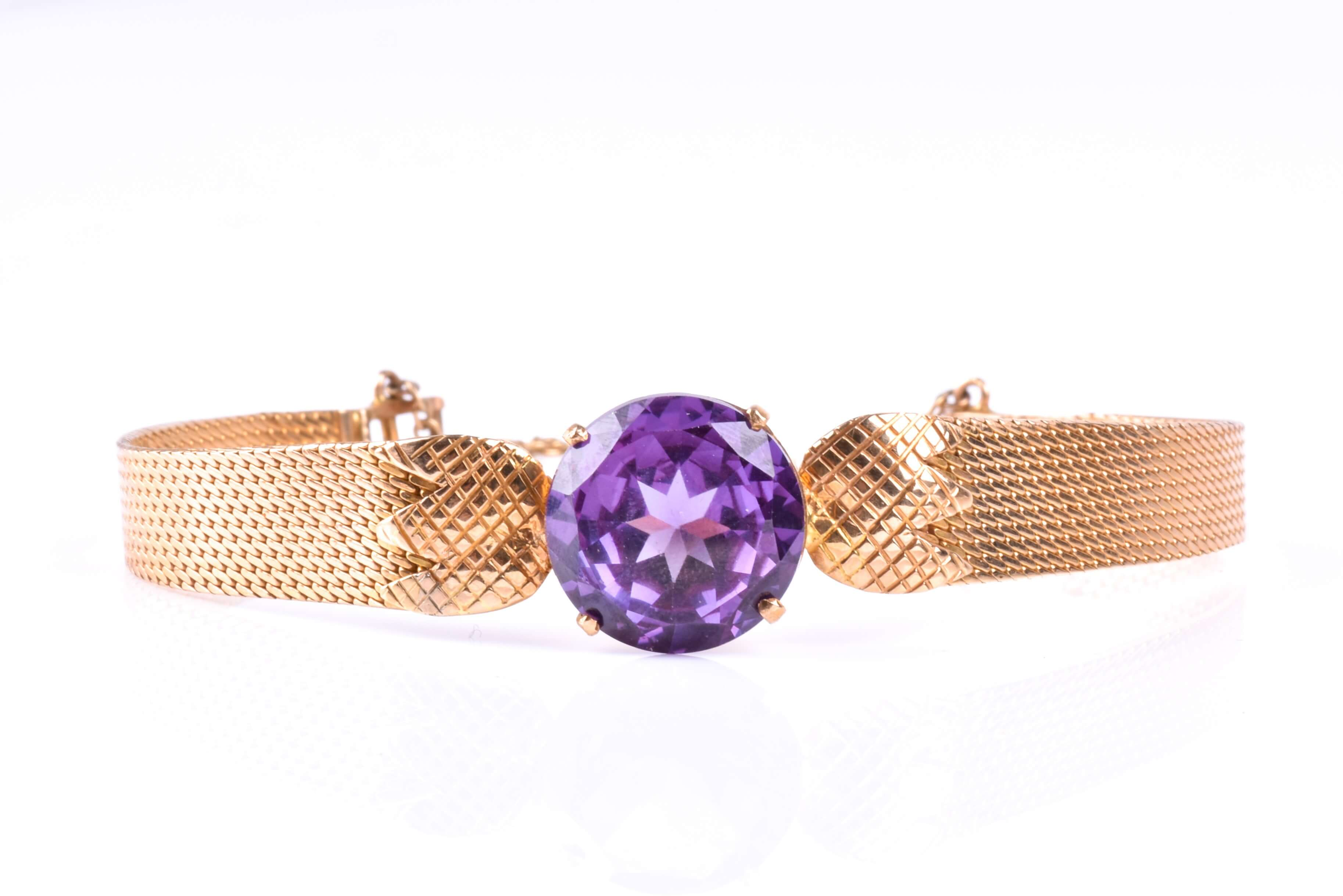 A yellow metal and synthetic corundum bracelet with Alexandrite-style stone