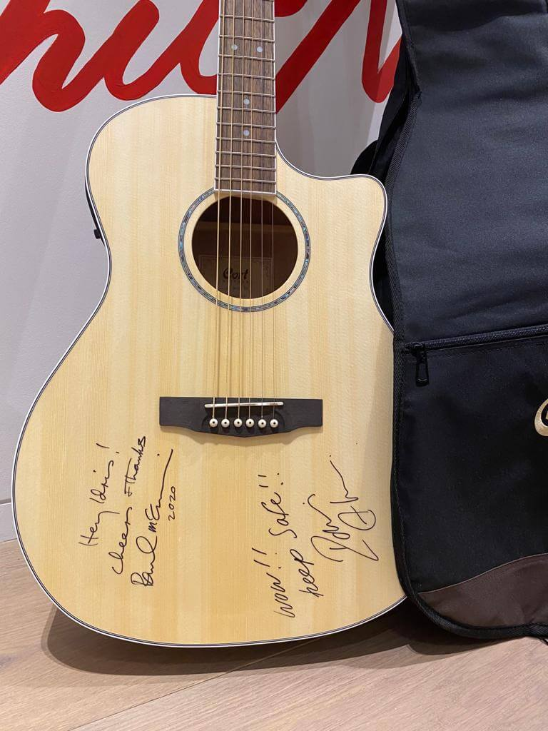A Unique Cort acoustic guitar signed by Sir Paul McCartney and Idris Elba raising funds for S.T.O.R.M. Charity. Sold for £10,500.