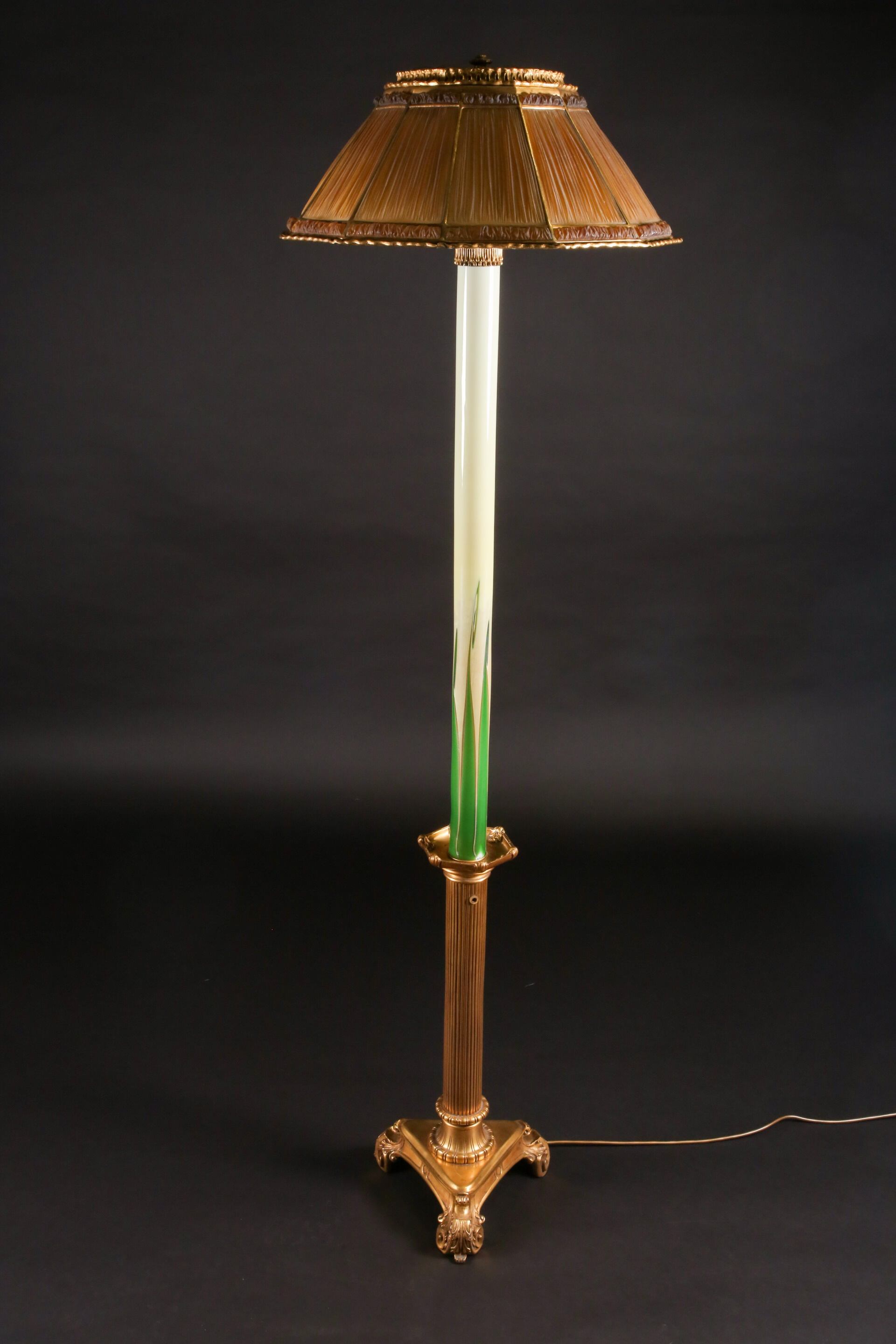 A Tiffany & Co moulded glass and gilt bronze mounted standard lamp