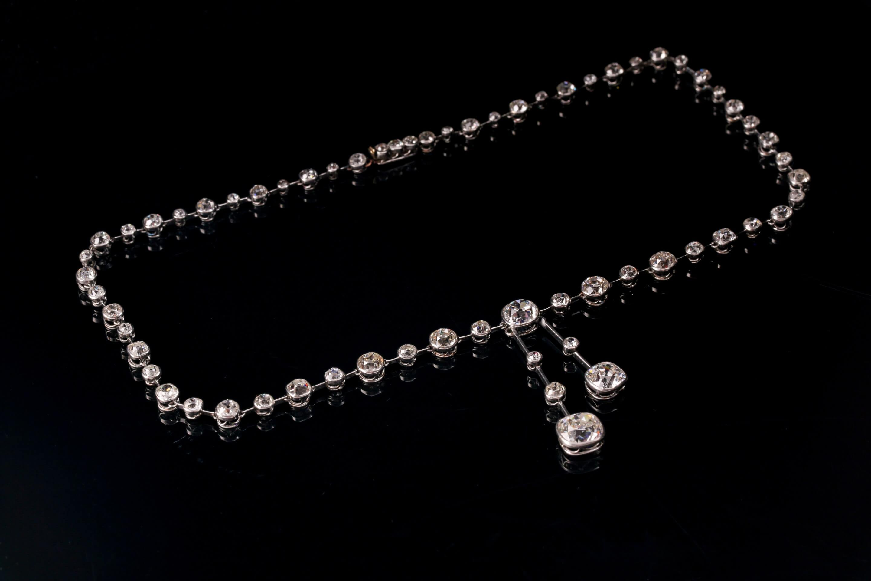 An impressive antique collet-set diamond lavliere necklace