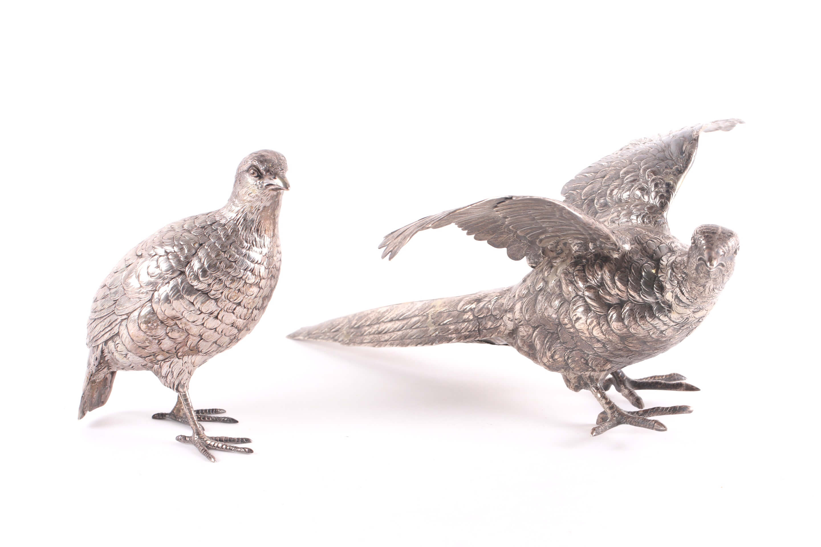 A silver pheasant cock and hen, each with import marks for Berthold Muller, 1910 & 1913
