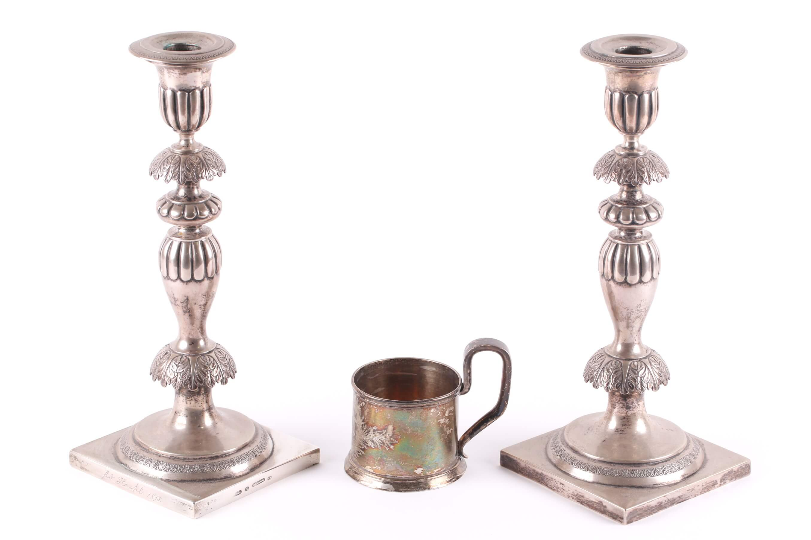 A pair of late 19th century Polish white metal table candlesticks