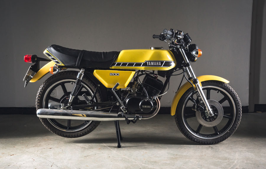 A Yamaha RD200 200cc yellow motorcycle