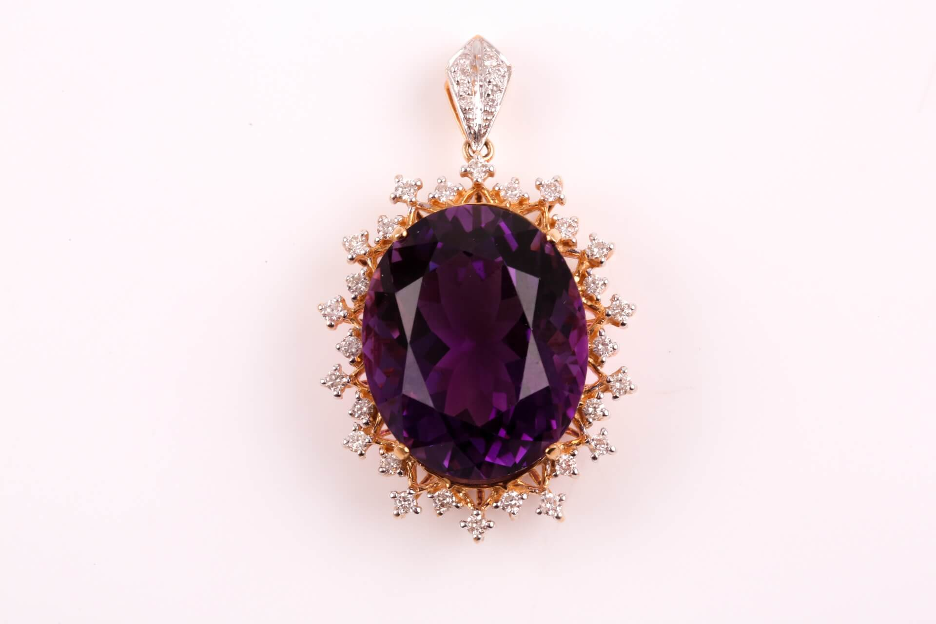 An 18ct yellow gold, diamond, and amethyst pendant by Lorique