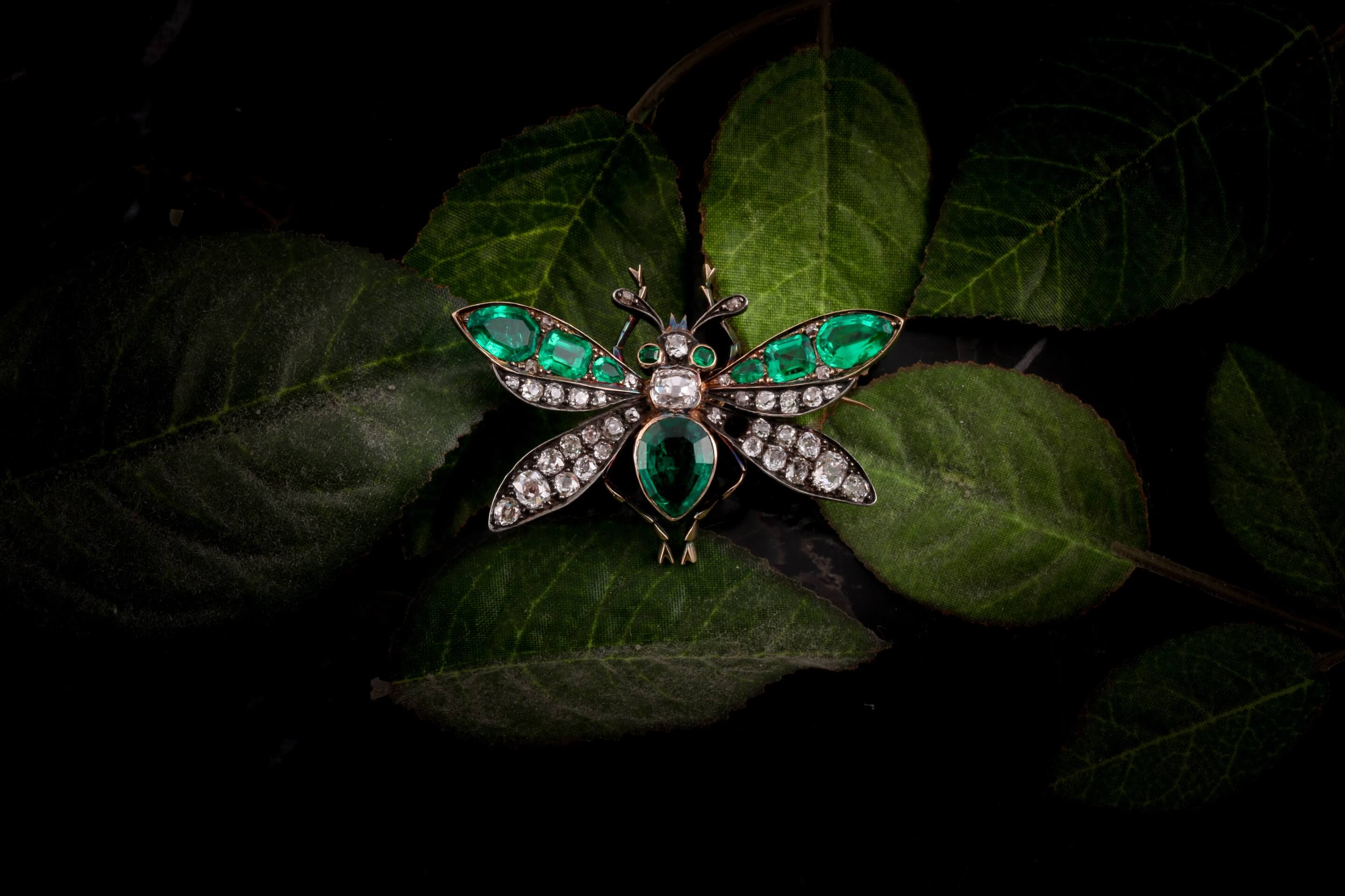 A Victorian diamond and emerald insect brooch