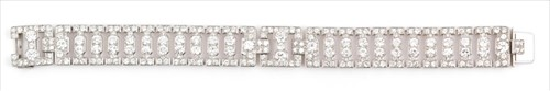 Lot 590-Cartier, London. An Art Deco diamond bracelet...