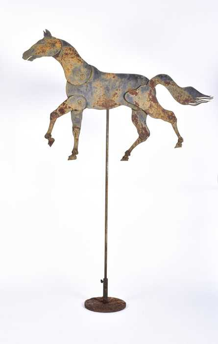 Lot 266-A 19th century iron articulated horse on stand...