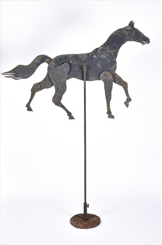 Lot 266 - A 19th century iron articulated horse on stand...