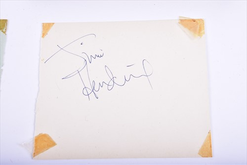 Lot 329-Jimi Hendrix: an autograph book containing two...