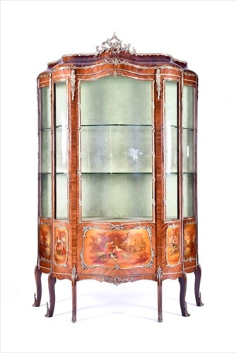 Lot 12 - A large Louis XV style serpentine front...