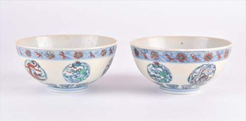Lot 121-A pair Chinese of porcelain doucai 'dragon' bowls ...
