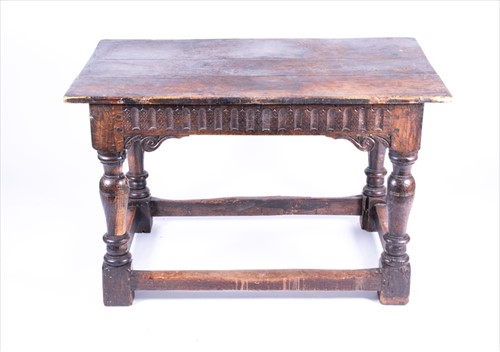 Lot 74-An 18th century oak refectory style dining table...