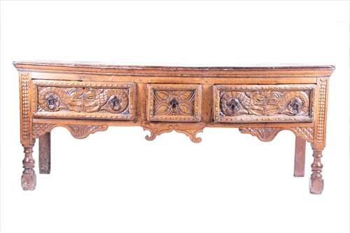 Lot 73-A 17th century oak dresser base with carved...