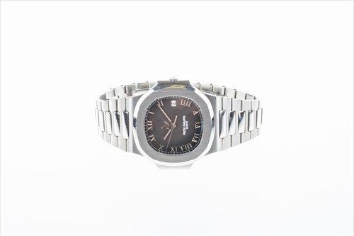 Lot 311-A fine and rare Patek Philippe Nautilus...
