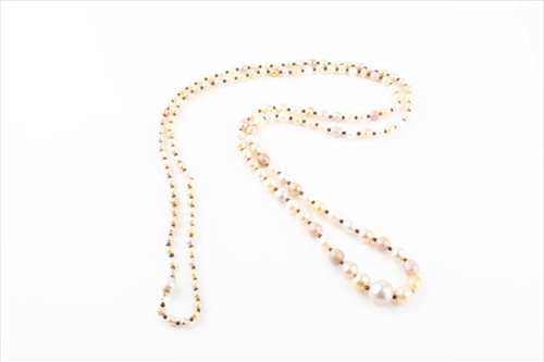 Lot 433 - An opera length natural pearl necklace...