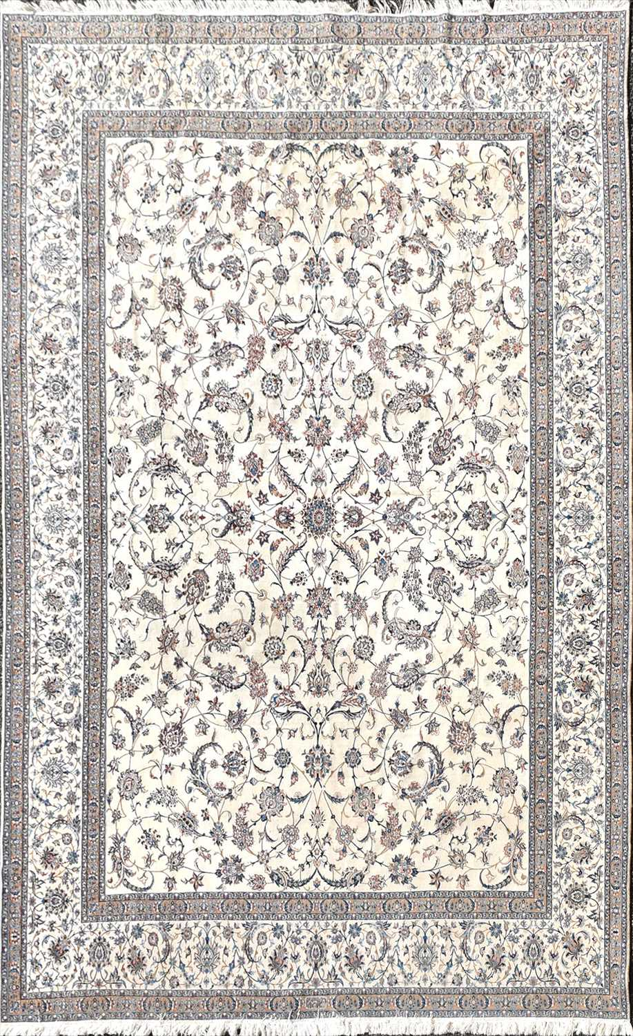 Lot 59 - A large Persian ivory ground wool andsilk...