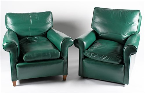 Lot 99-Two modern green leather club armchairs with...
