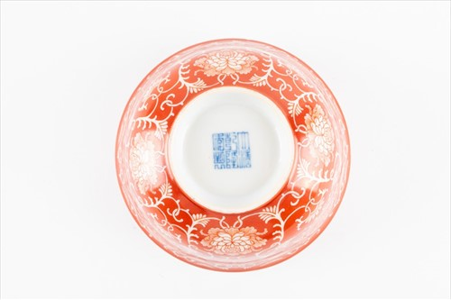 Lot 131 - A Chinese Qing dynasty coral red reverse...