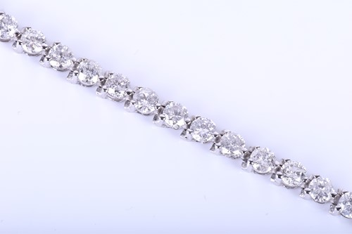 Lot 396-A 14k white gold and diamond line bracelet, set...