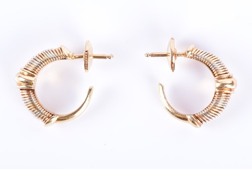 Lot 37-Cartier. A pair of 18ct yellow, white, and rose...