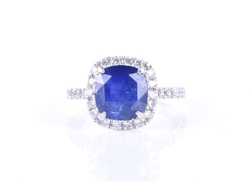 Lot 38-A diamond and sapphire cluster ring set with a...
