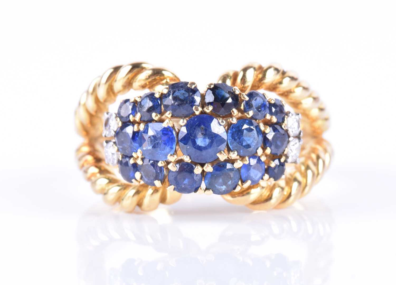 Lot 41-An 18ct yellow gold and sapphire bombe-style ring ...