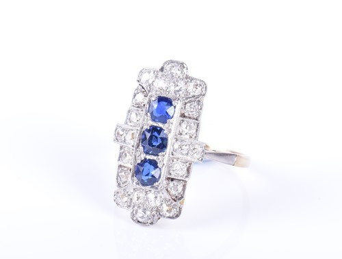 Lot 42-An Art Deco diamond and sapphire cocktail ring...
