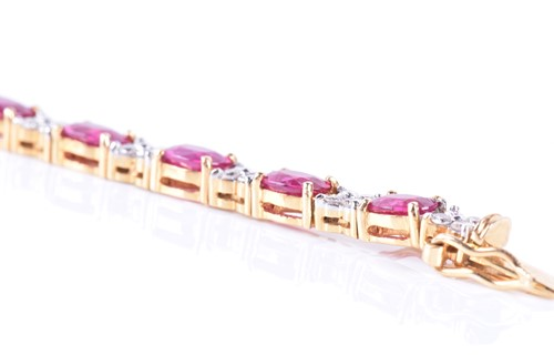 Lot 44-A fine 18ct yellow gold, diamond, and ruby line...