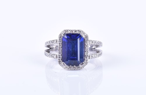 Lot 46-An 18ct white gold, diamond, and tanzanite ring...