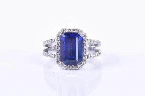 Lot 46-An 18ct white gold, diamond, and tanzanite ring...