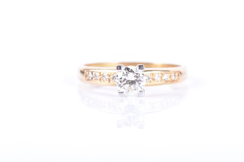 Lot 51-An 18ct yellow gold and diamond ring centred with ...