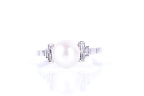Lot 2-A natural pearl and diamond ring set with a round ...
