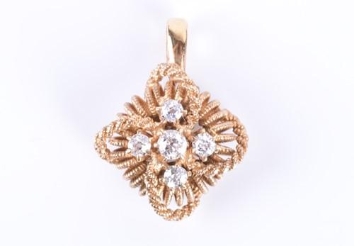 Lot 4-A yellow metal and diamond pendant of quatrefoil...