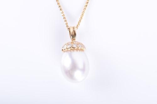 Lot 5-A diamond and South Sea pearl pendant the oval...