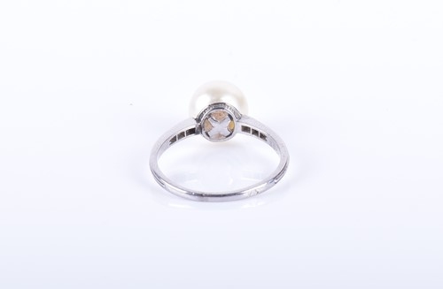 Lot 12-A Continental diamond and natural pearl ring set...