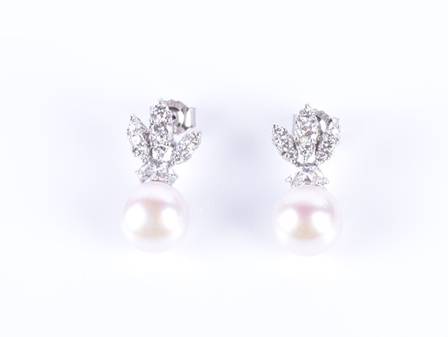 Lot 7-A pair of diamond and pearl earrings the fanned...