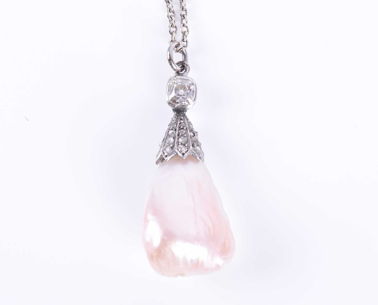 Lot 9-A natural freshwater pearl and diamond pendant...