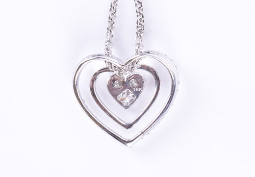 Lot 10-A diamond-set heart-shaped pendant centred with...