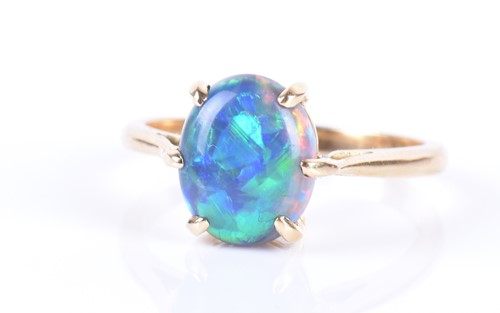 Lot 13-An 18ct yellow gold and opal ring set with an...