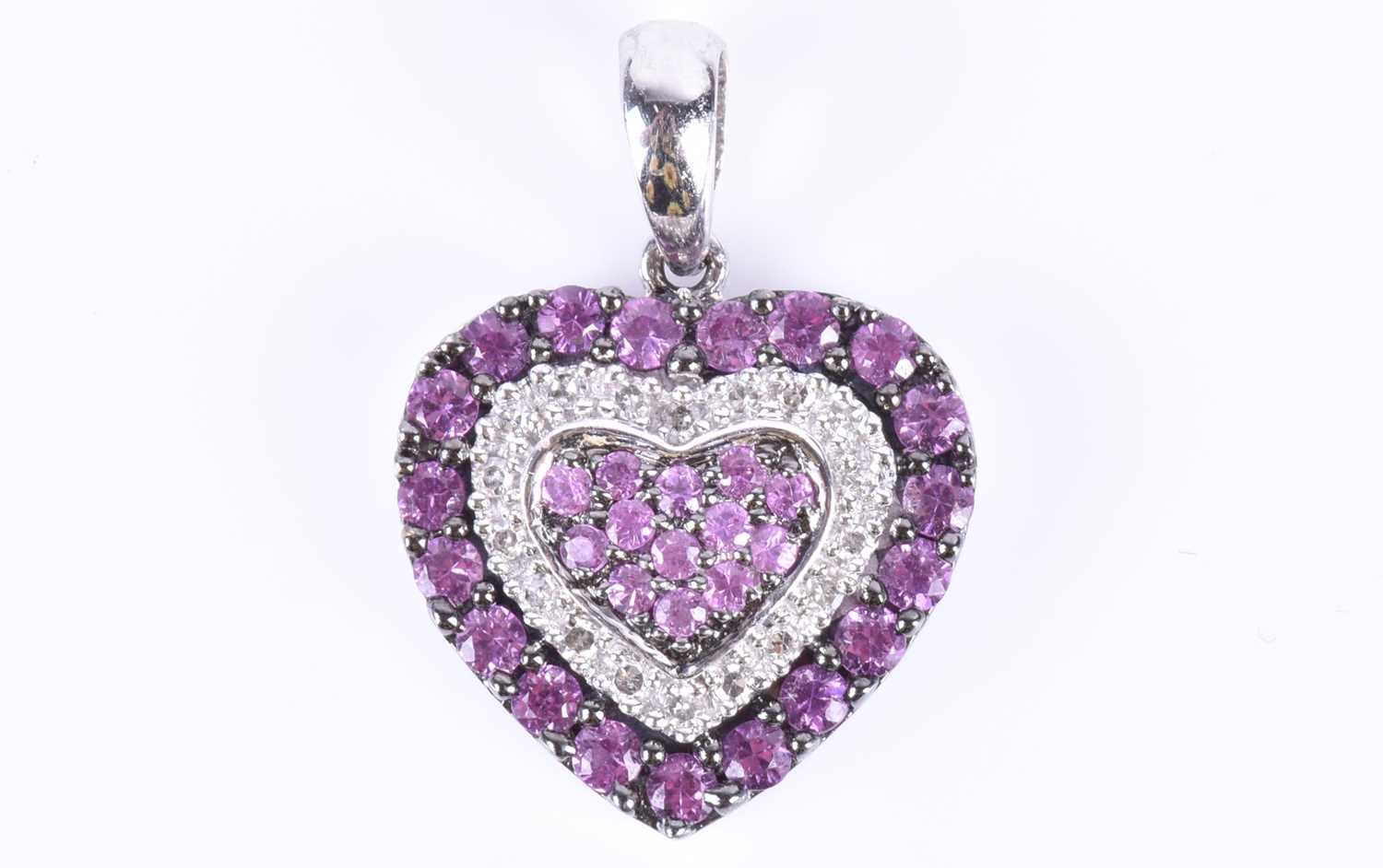 Lot 14-An 18ct white gold, diamond, and pink sapphire...