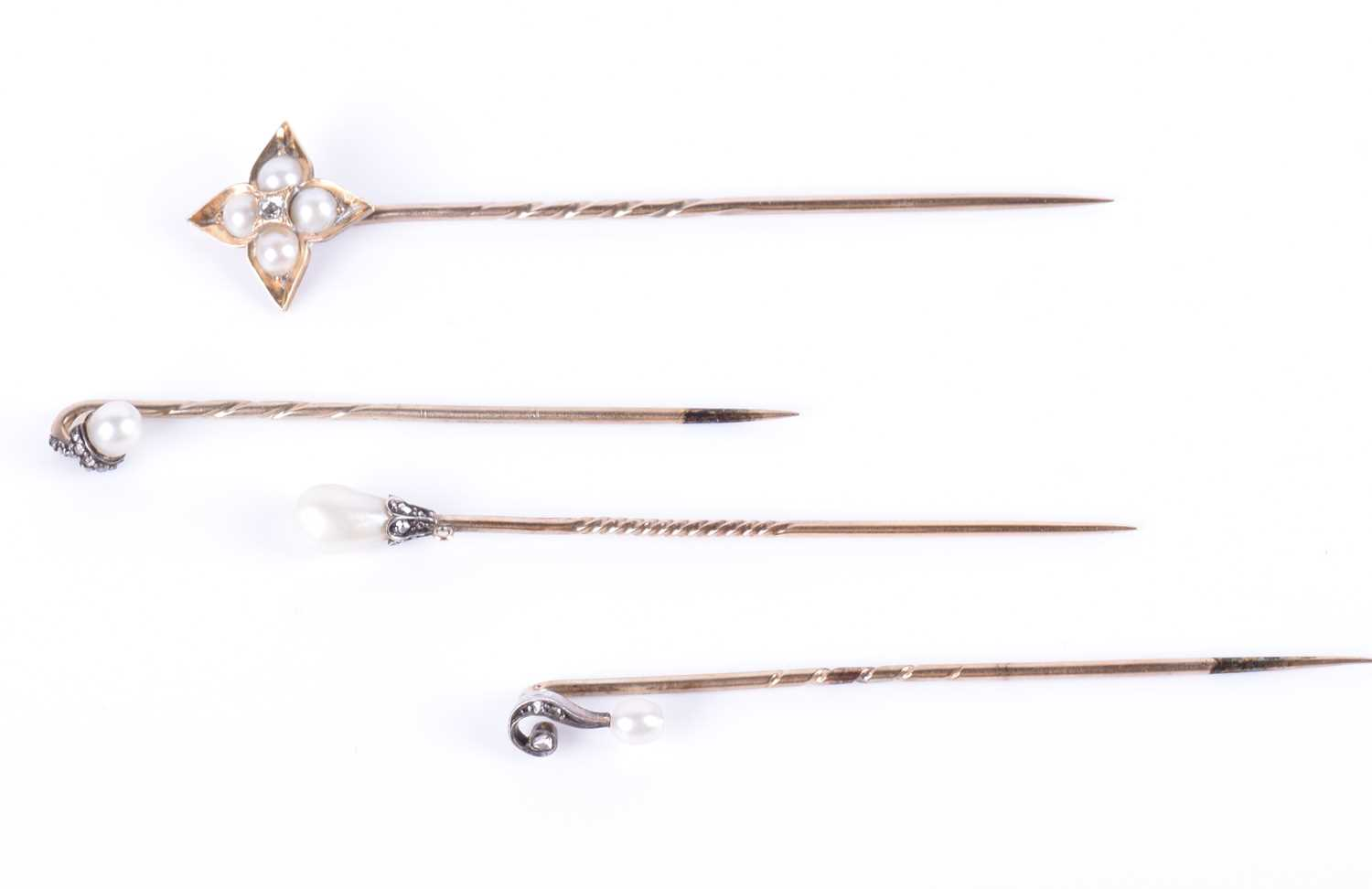 Lot 16-A yellow metal, pearl, and diamond stick pin of...