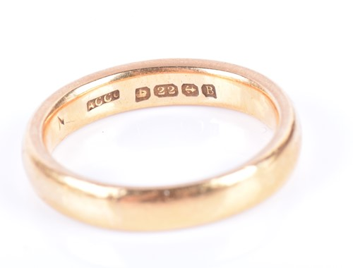 Lot 19-A 22ct yellow gold wedding band size L, together...