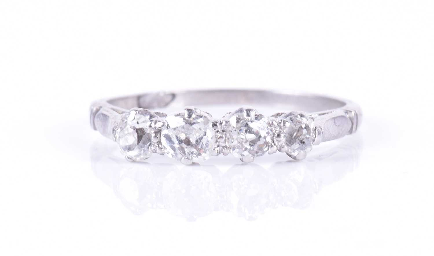 Lot 20-A four-stone diamond ring set with four old-cut...