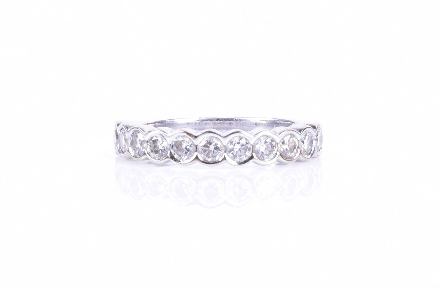 Lot 23-A diamond half-eternity ring bezel-set with...