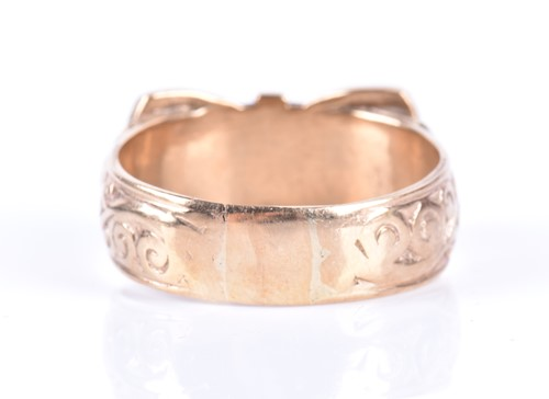 Lot 24-A gentleman's 9ct yellow gold ring in the form of ...