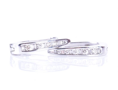 Lot 43-A pair of 14ct white gold and diamond hoop...